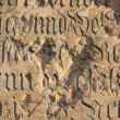 Stone texture with carved text in German — Stock Photo