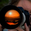 Photographer takes picture of sunset — Stock Photo