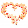 Heart from yellow orchid flowers — Stock Photo