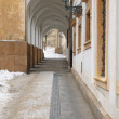 Narrow arched passage towards historical courtyard at old town — Stock Photo