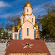 Orthodox chapel and Eternal Fire memorial in Vladivostok — Stock Photo #33812043