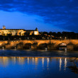 Evening view of Charles Bridge from Novotneho Lavka, Prague — Stock Photo