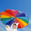 Baby boy on the beach under umbrella, copyspace  — Stock Photo