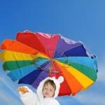 Baby boy on the beach under umbrella, copyspace — Stock Photo