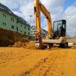 Yellow excavator on the construction site — Stock Photo #33812155
