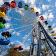 Ferris wheel against blue sky — Stock Photo #33812157