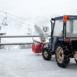 Snow cleaning tractor on ski resort — Stock Photo