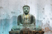 Kamakura Great Buddha on stone background — Stock Photo