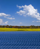 Solar power plant and rapesed field in Germany — Stock Photo