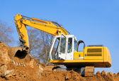 Yellow excavator on the construction site — Stock Photo