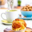 Tasty muffin on breakfast table — Stock Photo