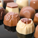 Chocolate truffles on black, text space — Stock Photo