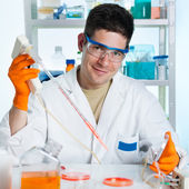 Young cell biologist working — Stock Photo