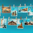 Pictures of european landmarks pinned on ropes, toned image — Stock Photo #36315457