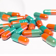 Closeup on red-green capsules with medication — Photo