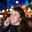 Woman with a phone in city — Stock Photo