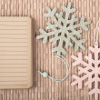 Notebook and decorative snowflakes — Stock Photo
