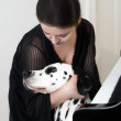 Woman gives a hug to dalmatian dog — Stock Photo