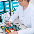 Stock Photo: Tech repairs electronic equipment