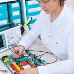 Tech repairs electronic equipment — Stock Photo