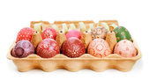 Crate with painted Easter Eggs — Stock Photo