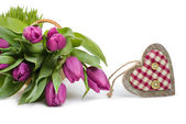 Fresh tulips and wooden heart, space — Stock Photo