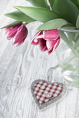 Pink tulips and wooden heart, text space — Stock Photo