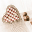 Chocolate truffle and a wooden heart — Stock Photo
