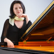 Pianist by grand piano — Stock Photo #41454253