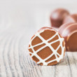 Stock Photo: Chocolate truffles on wooden surface, text space