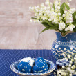 Blue and white Easter decorations on wood, text space — Stock Photo