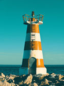 Small lighthouse in Cuarteira, Portugal — Stock Photo