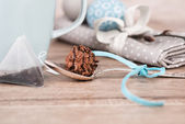 Choco9late truffle in a tea spoon — Stock Photo