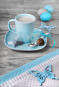 Cup of tea and Easter decorations — Stock Photo