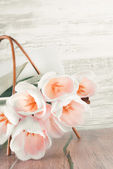 Creamy tulips in the basket  — Stock Photo