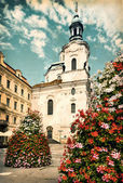 Aged picture of St. Nicolas Church in Prague — Stock Photo