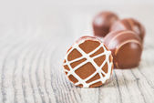 Chocolate truffles on a wooden surface, text space — Stock Photo
