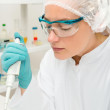 Stock Photo: Young female tech or scientist works in lab