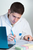 Young scientist reads fresh publication — Stock Photo