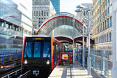 Train approaches docklands station in London  — Stock Photo