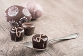 Chocolate truffles on a wooden table, text space — Stock Photo