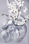 Easter composition with eggs and cherry blossoms, tinted image — Stock Photo