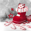 Santa's boot with candy canes and Xmas decorations — Stock Photo #46430929