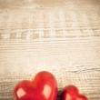 Two stone hearts on a wooden table — Stock Photo #46430997