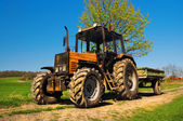 Red rusty tractor — Stock Photo