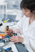 Tech tests electronic equipment — Stock Photo