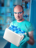 Scientist with box of samples — Stock Photo