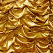 Shiny gold fabric curtain texture — Stock Photo