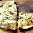 Light crispy pizza serve on wooden board — Foto de Stock