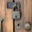 Old lock on wooden door — Stock Photo